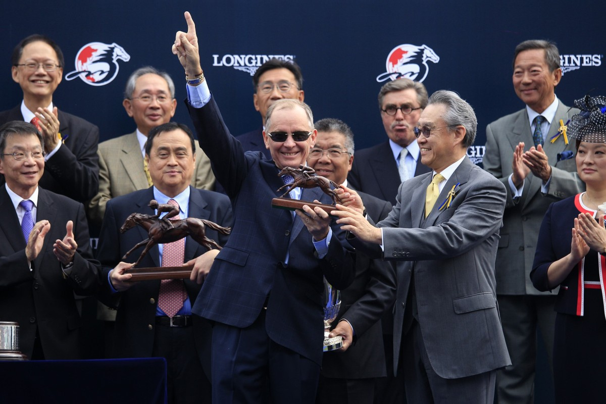 John Moore raises his hand in triumph after winning his first Hong Kong Vase.