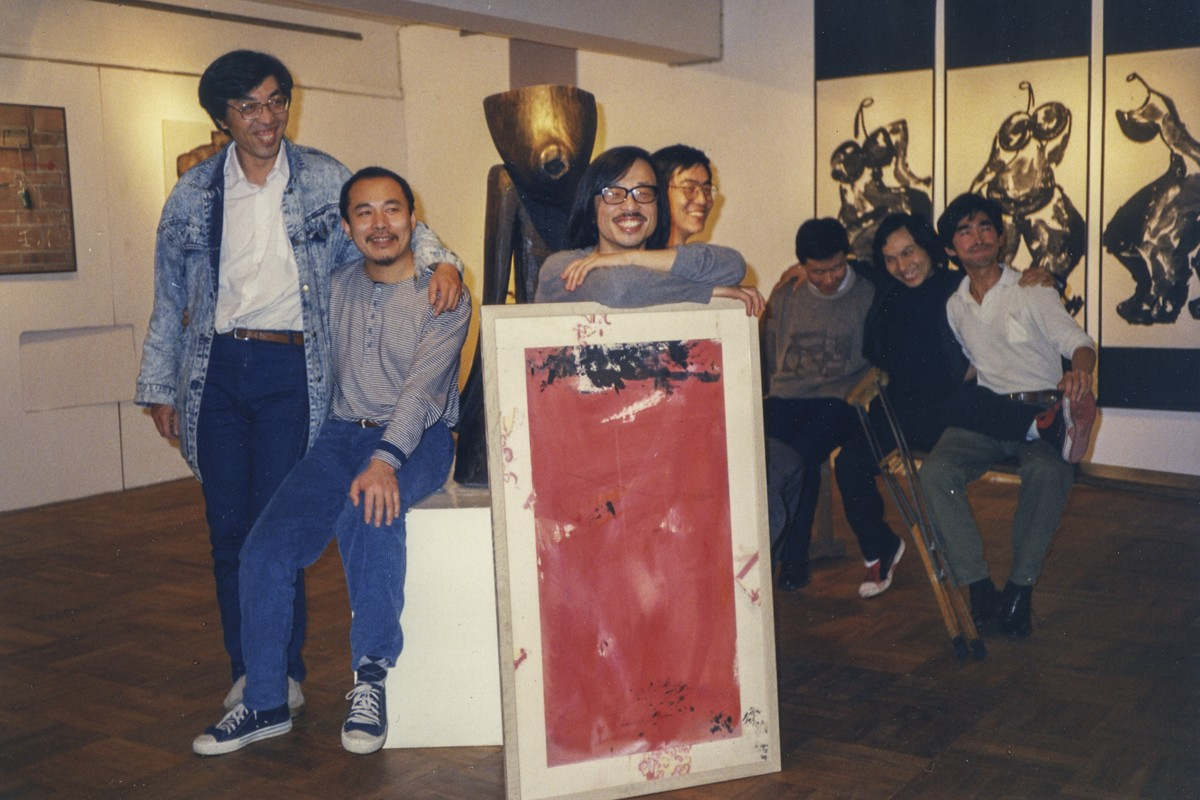 "(From left) artists Mao Lizi, Wang Keping, Huang Rui, Bo Yun, Qu Leilei and Ma Desheng with Chang at ""The Stars: 10 Years"" exhibition at the Hanart TZ Gallery, in January 1989."