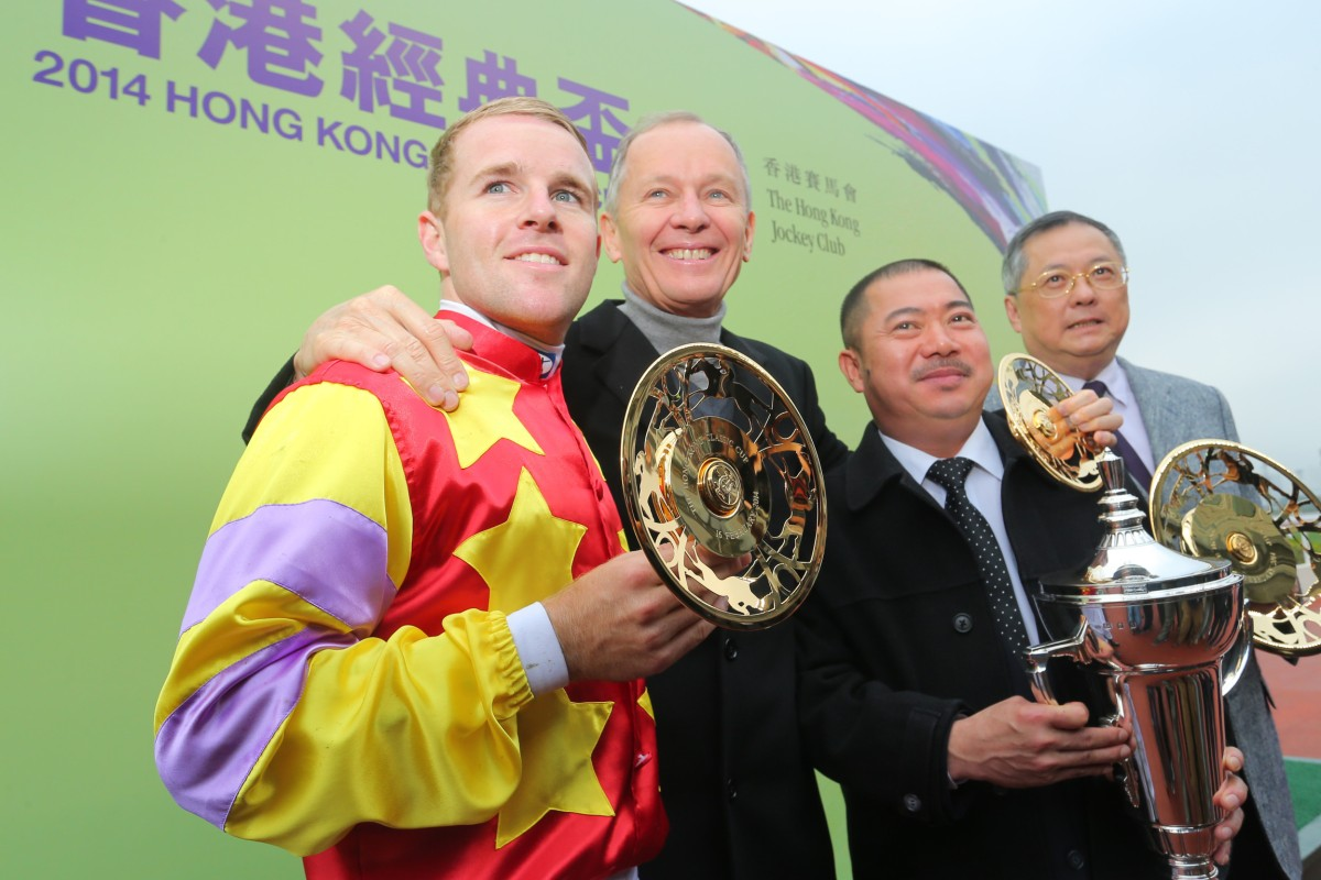 Jockey Tommy Berry (far left), trainer John Moore (middle left) and owner Cheng Keung Fai (far right) celebrate Designs on Rome's Classic Cup success. Photo: Kenneth Chan