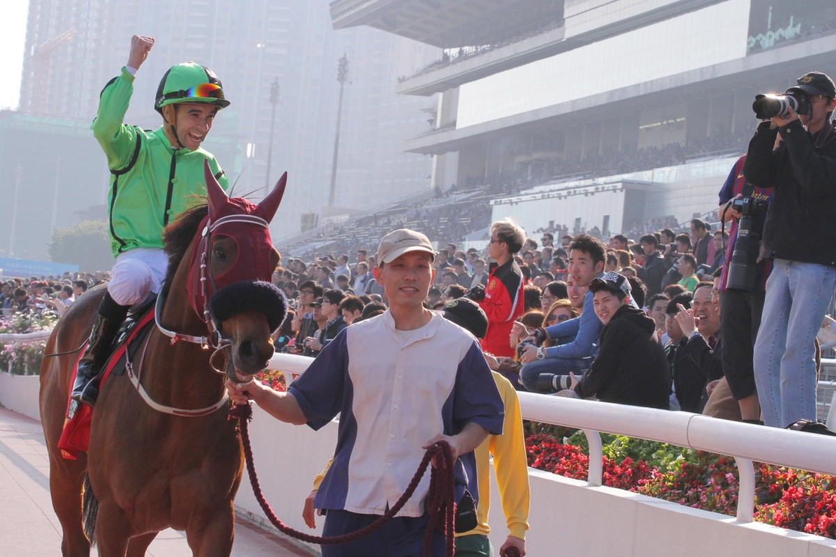 A jubilant Joao Moreira parades Military Attack in front of the Sha Tin crowd as the reigning Horse of the Year heads back to the winner's circle. Photos: Kenneth Chan
