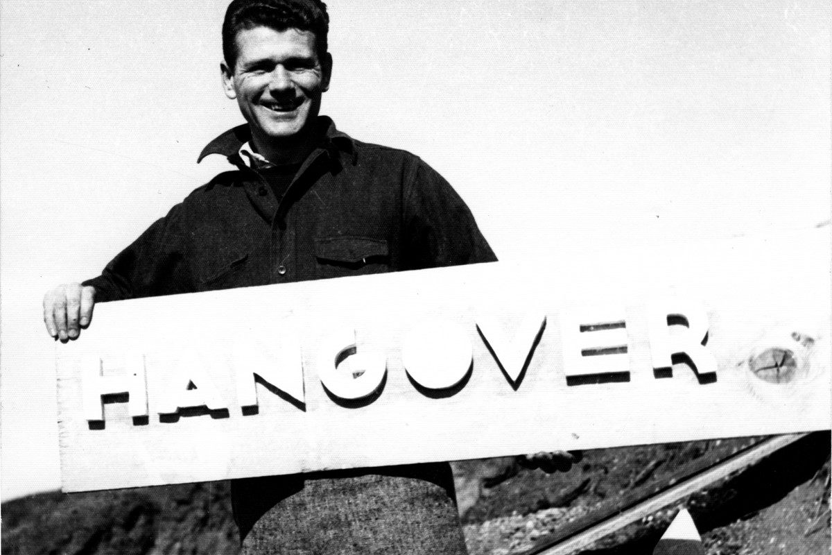 Writer Paul Mooney with the sign for Hangover House.