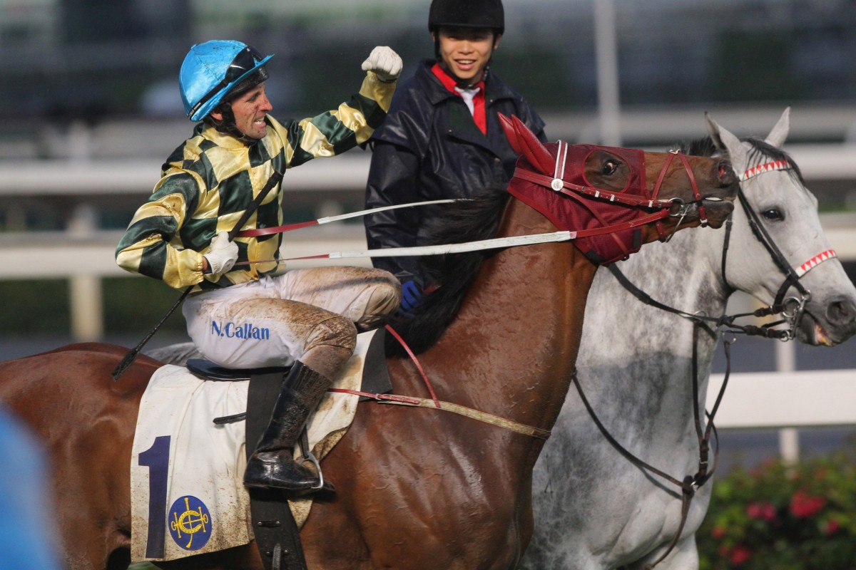 Neil Callan returns to the winner's circle on Rewarding Hero, two races after an improper riding incident with Eddy Lai Wai-ming - perhaps giving a demonstration. Photo: Kenneth Chan