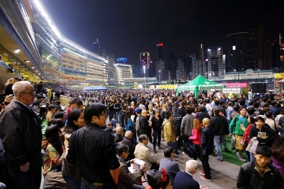 A packed Happy Valley crowd enjoys the beer garden. This sight won't be seen again until October. Photo: Kenneth Chan