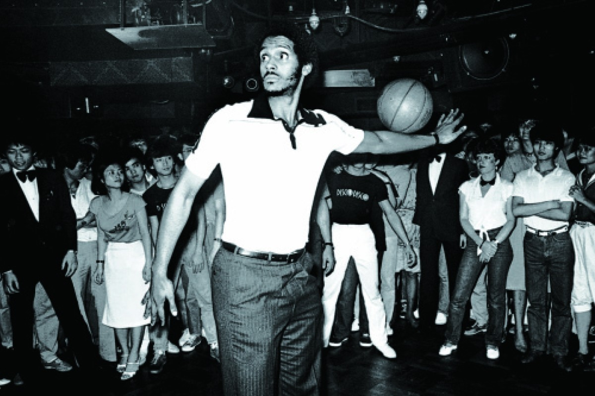 A Harlem Globetrotter Takes The Floor At Disco