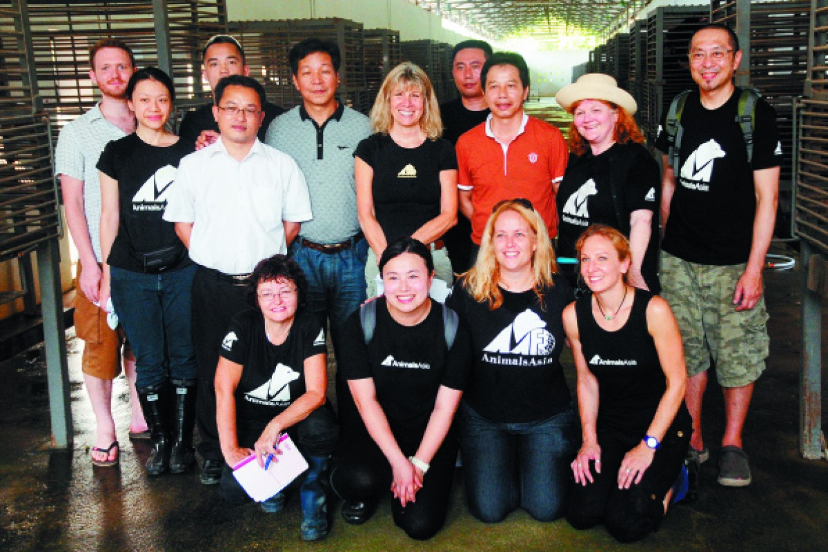 Nicol and Yan with Jill Robinson and other Animals Asia staff at the Nanning farm.