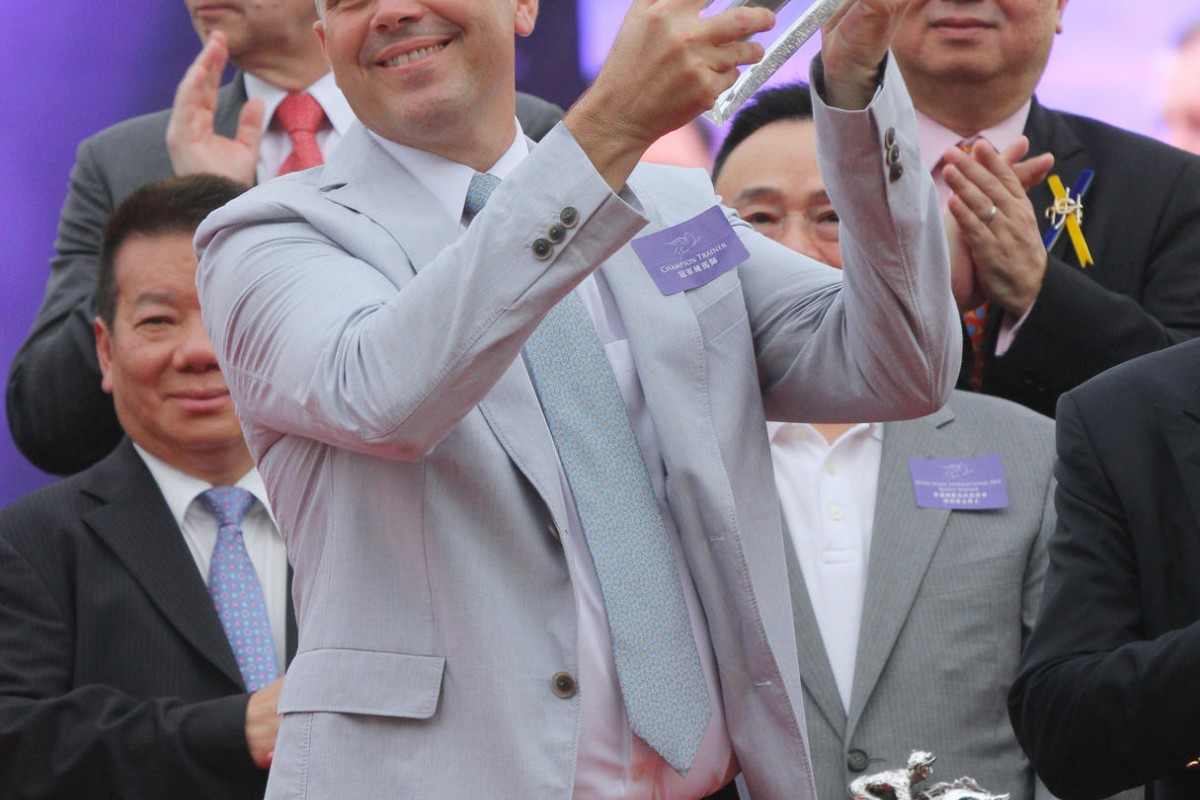 Caspar Fownes holds aloft the trainers' championship trophy for a third time at Sha Tin. Photo: Kenneth Chan