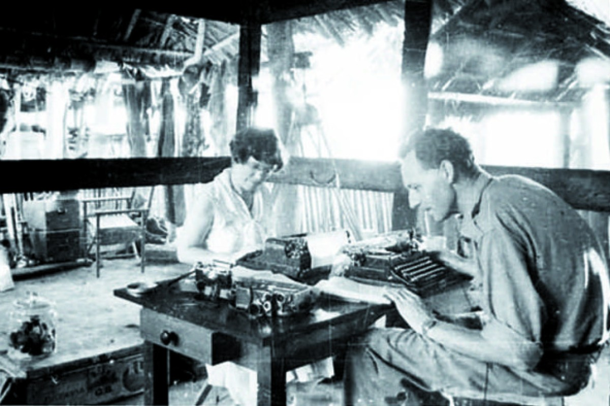"Mead and Gregory Bateson at work in the ""mosquito room"", Tambunan, Malaysia, in 1938."
