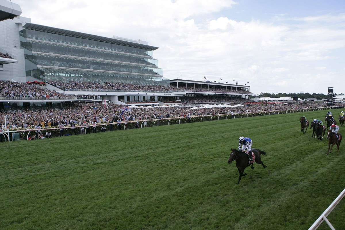 Protectionist (Ryan Moore) races away to win the Melbourne Cup in front of a large Flemington crowd, with Red Cadeaux (Gerald Mosse) holding down second. It was his third runner-up finish from four attempts. Photo: Reuters