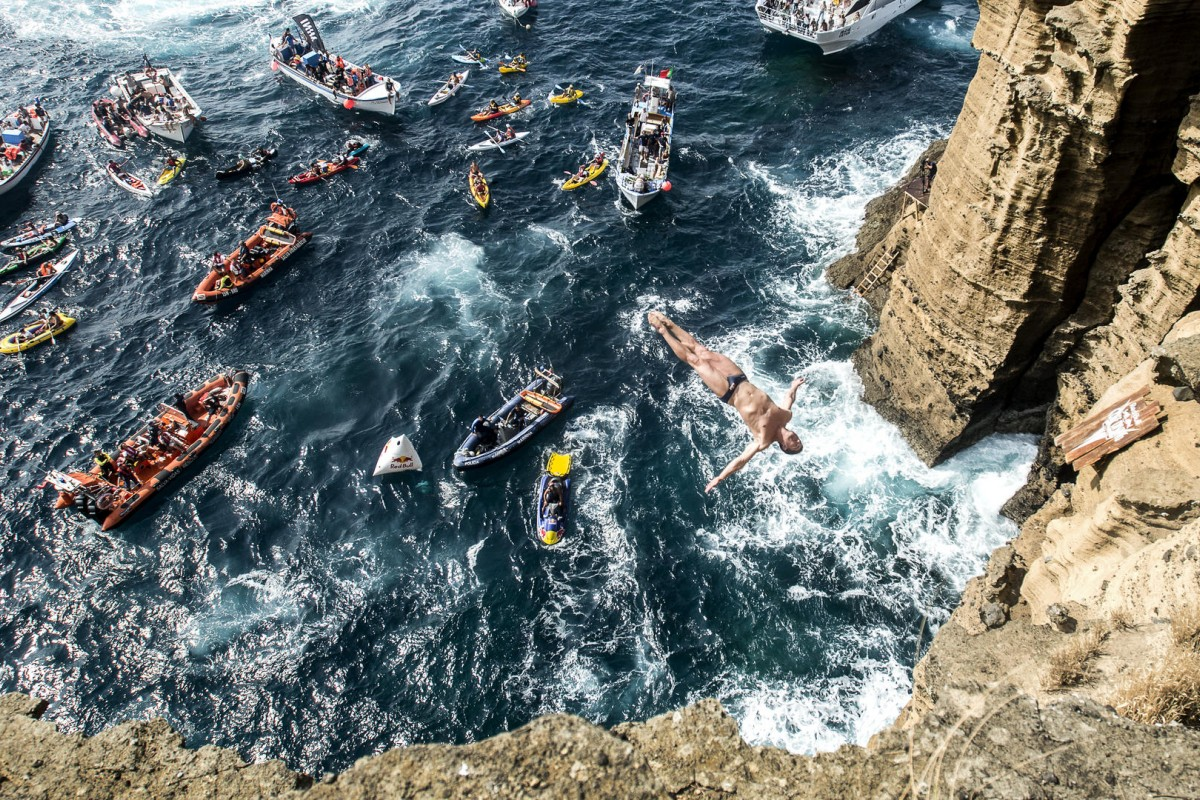 Professional diver David Colturi dives off a high cliff. Photos: Red Bull Media House; Thinkstock