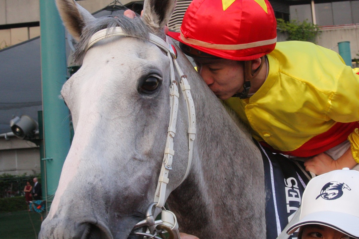 Matthew Chadwick celebrates aboard California Memory after they win the Hong Kong Cup in 2012.