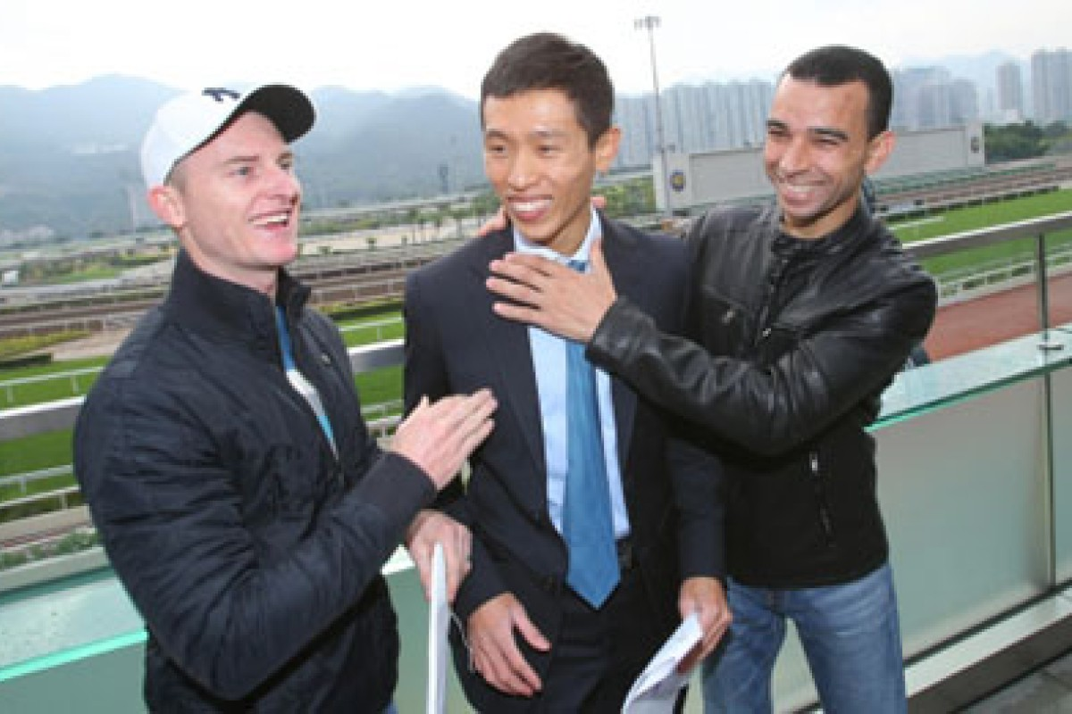 Zac Purton and Joao Moreira, pictured on either side of Vincent Ho, will miss part of Sunday's Sha Tin card. Photo: Kenneth Chan
