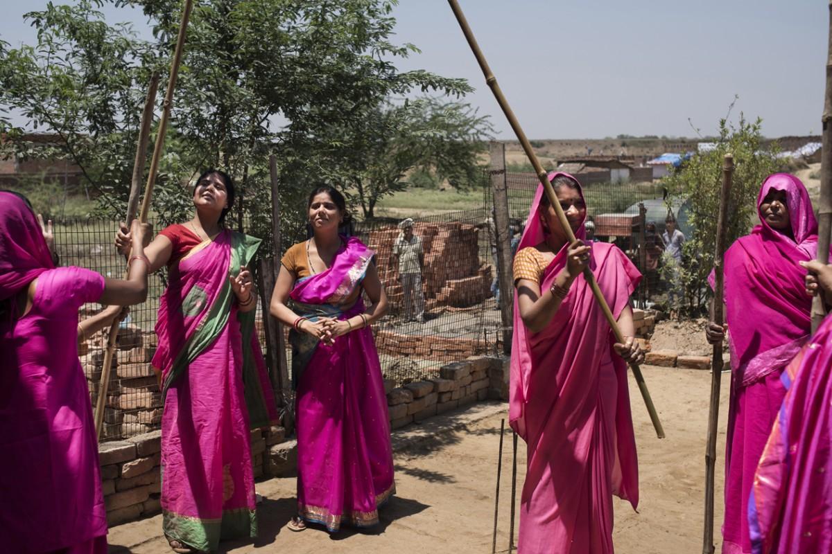 Gulabi Gang members practise wielding their bamboo sticks. Photos: Zigor Aldama; Miguel Candela