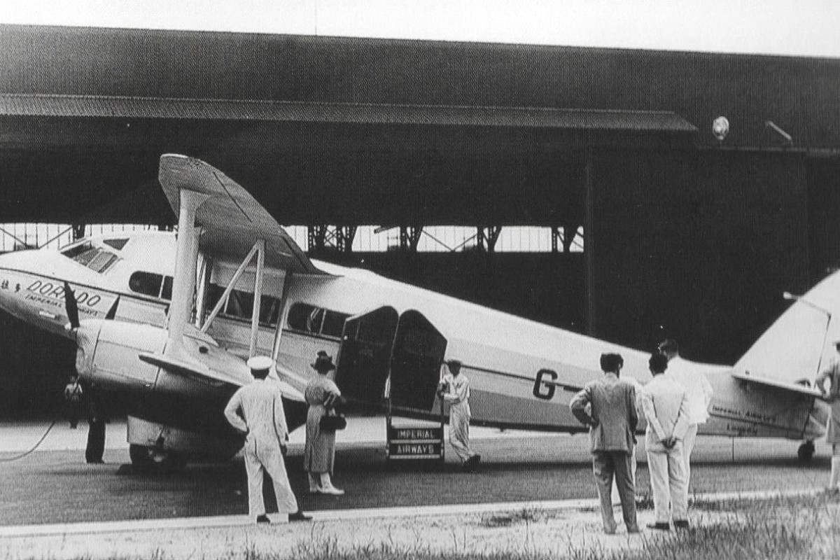 A 10-seat, four-engine de Havilland 86  at Kai Tak airport after completing the first flight by Imperial Airways to Hong Kong in 1936.  British Airways is celebrating the anniversary of the flight this year.