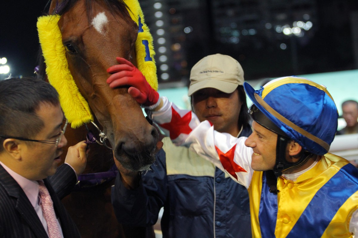 Brett Prebble gives Happy Rocky a pat after his win on Wednesday.