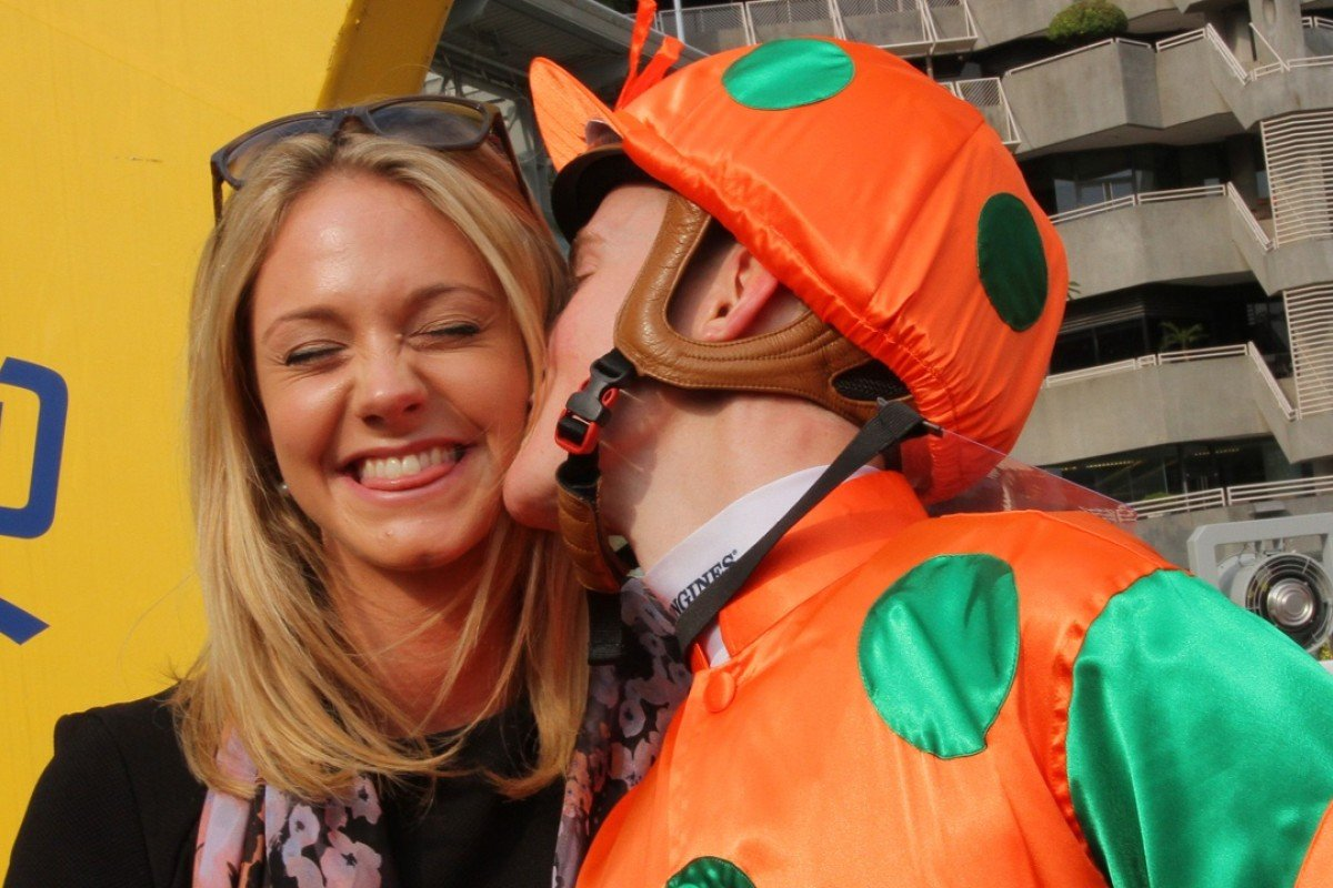 It was smiles all around, with Chad Schofield kissing girlfriend Hannah on Valentine's Day after leading home a father-son quinella on Richard Gibson's Ho Lee Horse on Sunday. Photo: Kenneth Chan