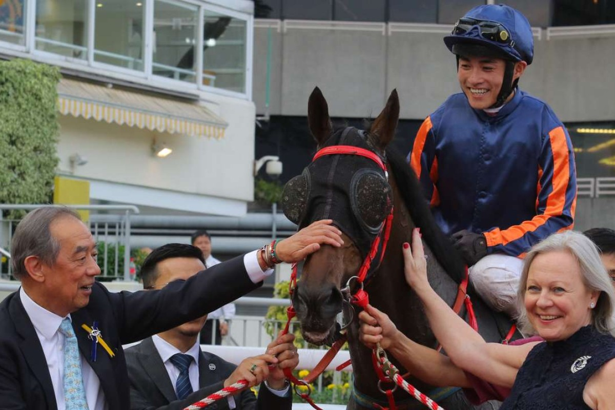 Ronald Arculli and wife Johanna celebrate Red Dancer's victory with jockey Keith Yeung. Photo: Kenneth Chan