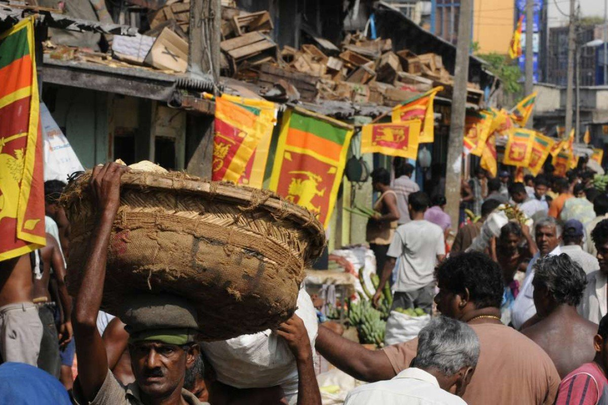 Sri Lankan national flags are seen at the main market in celebration of the country's military victory against Tamil Tiger rebels in Colombo. Picture: AFP