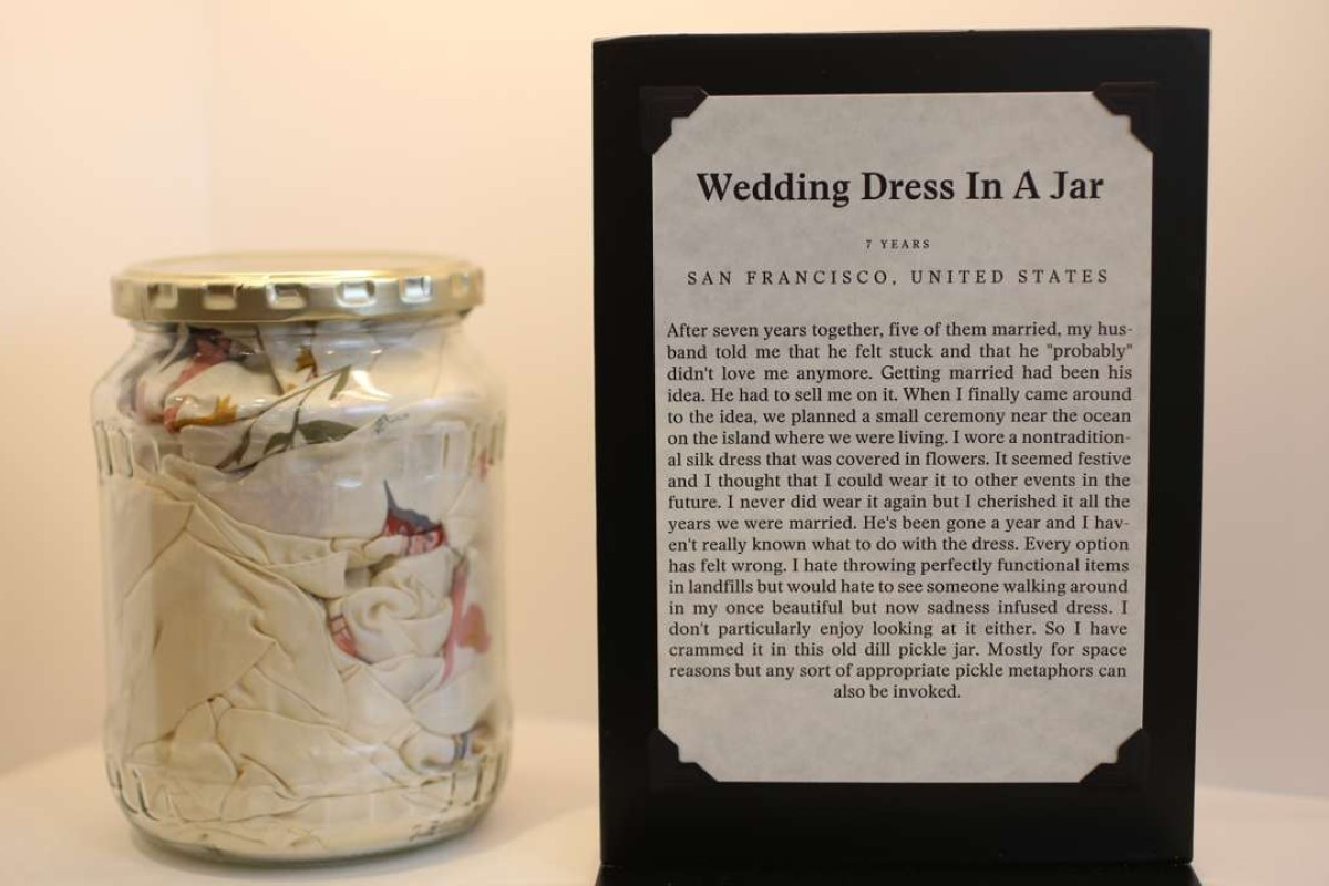 The Museum of Broken Relationships received this wedding dress stuffed into a pickle jar after a marriage went sour. Picture: Iris Schneider for The Washington Post.