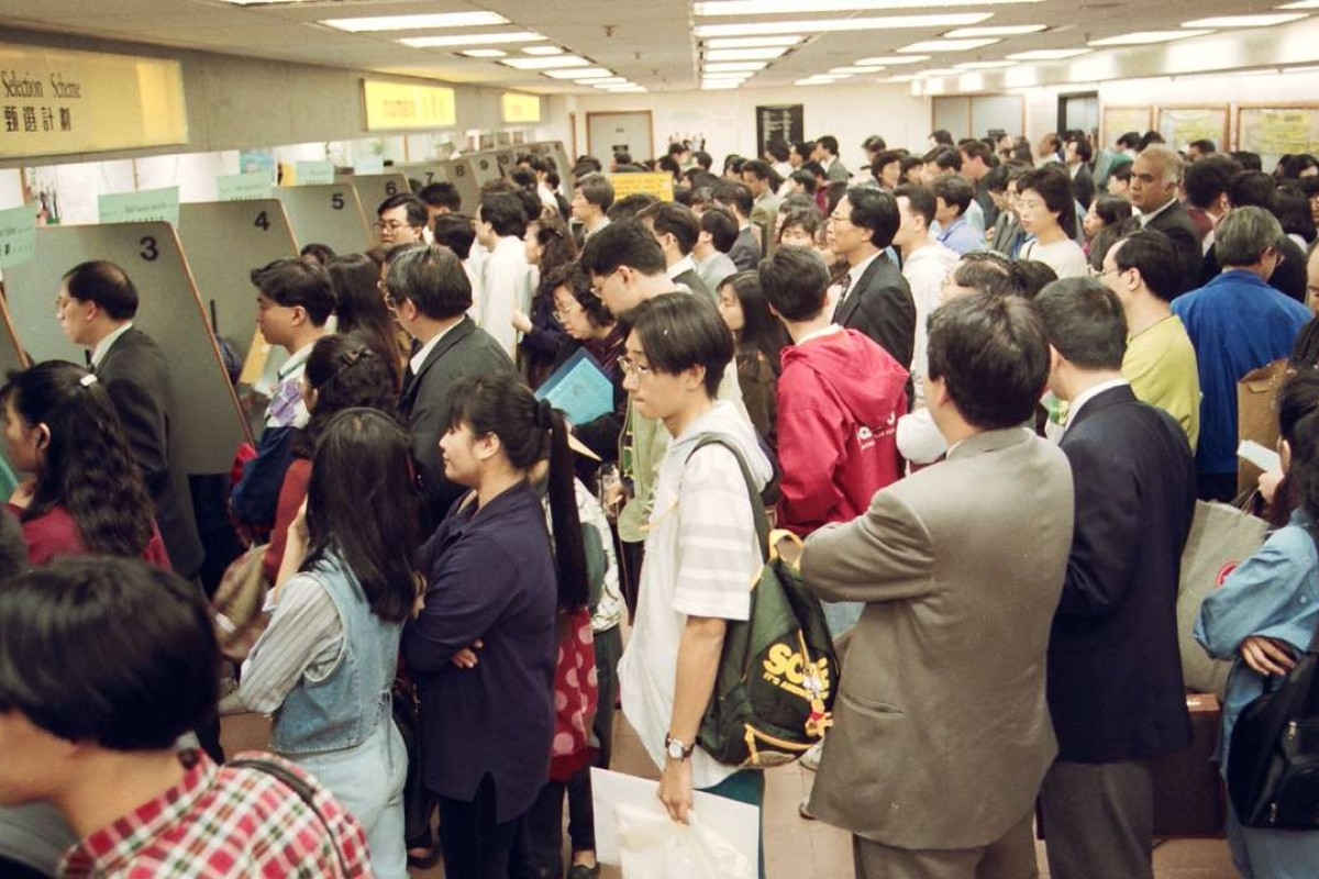 Hong Kong residents queue up in Immigration Tower, in Wan Chai, to apply for British passports before the handover. Pictures: SCMP