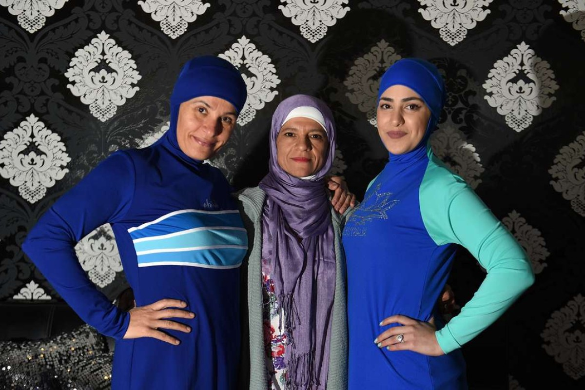 Models clad in burkini swimsuits pose with Australian-Lebanese designer Aheda Zanetti in western. Photo: AFP