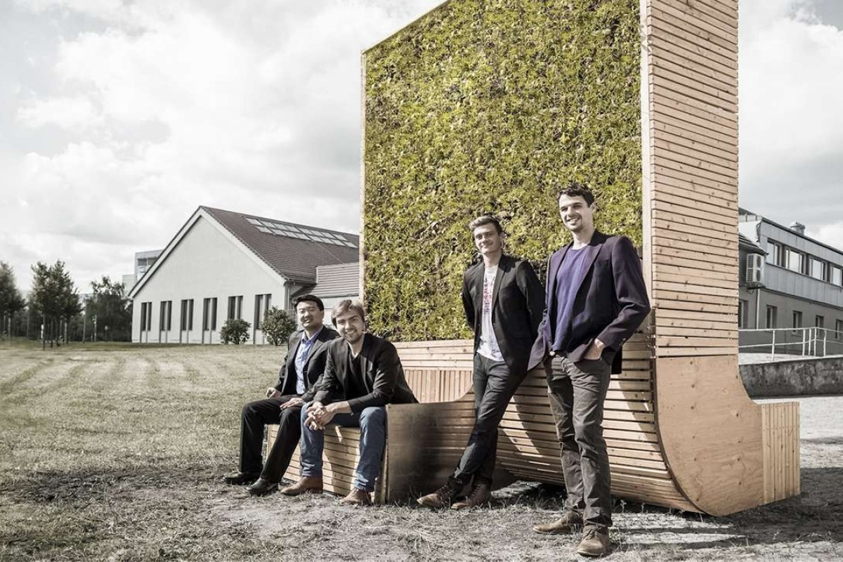 Green City Solutions' co-founders (from left) Wu Liang, Dénes Honus, Peter Sänger and Victor Splittgerber with a CityTree prototype, in Dresden, Germany.