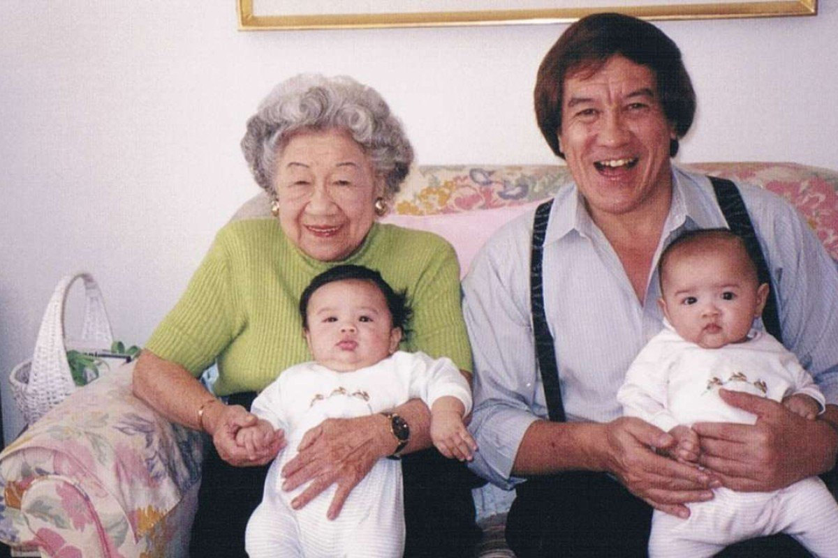 Ian Gill and his mother 'Billie' hold the author's children Sabrina and Brian – named after his half-brother who died in wartime Hong Kong – in 1999. Photo: Courtesy of Ian Gill