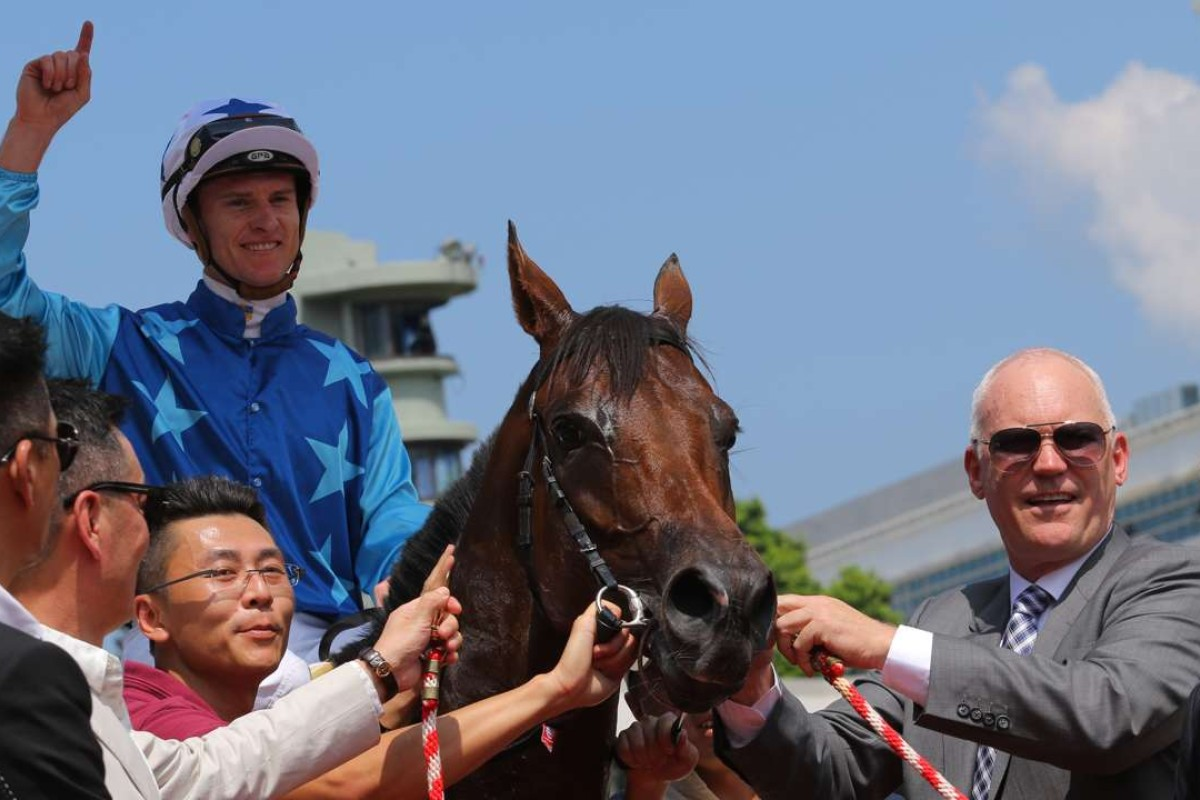 Jockey Zac Purton and trainer David Hall with the promising Jing Jing Win. Photos: Kenneth Chan