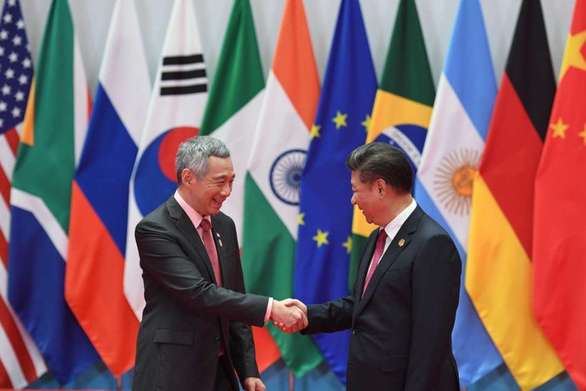 Singapore's Prime Minister Lee Hsien Loong shakes hands with China's President Xi Jinping at the G20 summit in Hangzhou. Photo: AFP