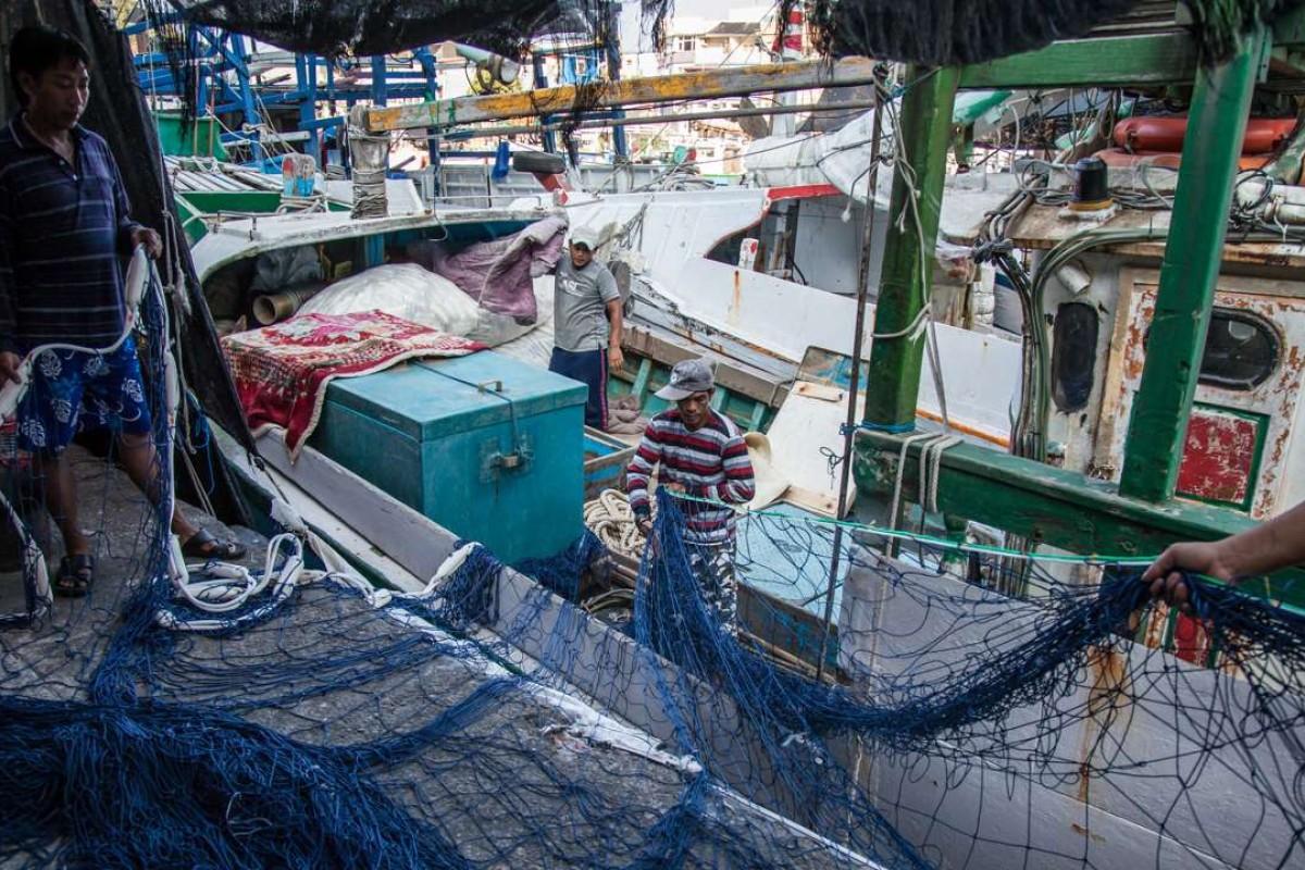 Filippino fishermen at Nanfangao harbour near Yilan, Taiwan. Pictures: Paul Ratje