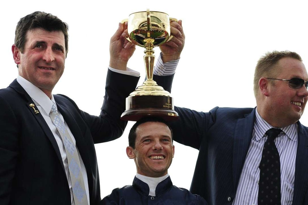 Trainer Robert Hickmott, jockey Brett Prebble and owner Nick Williams celebrate after Green Moon's Melbourne Cup win in 2012. Photos: EPA/JULIAN SMITH