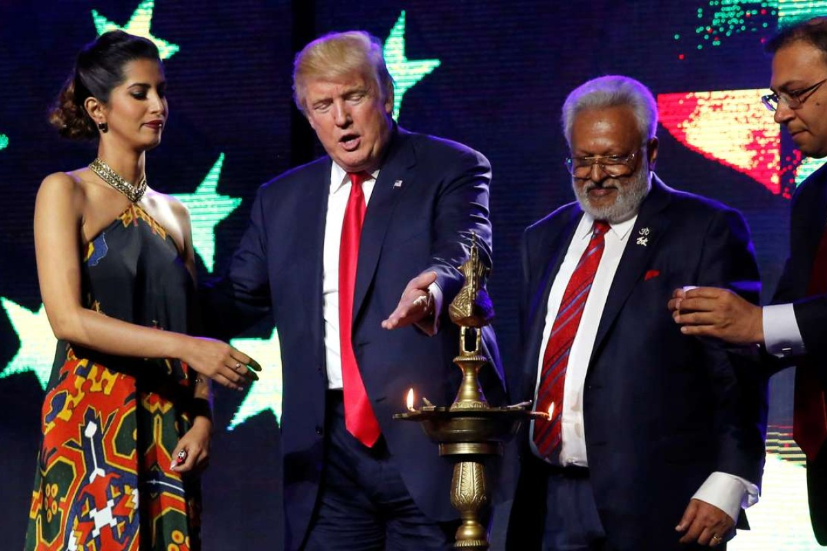Presidential nominee Donald Trump light a ceremonial diya lamp before speaking at a Bollywood-themed charity concert put on by the Republican Hindu Coalition in the US. Photo: Reuters