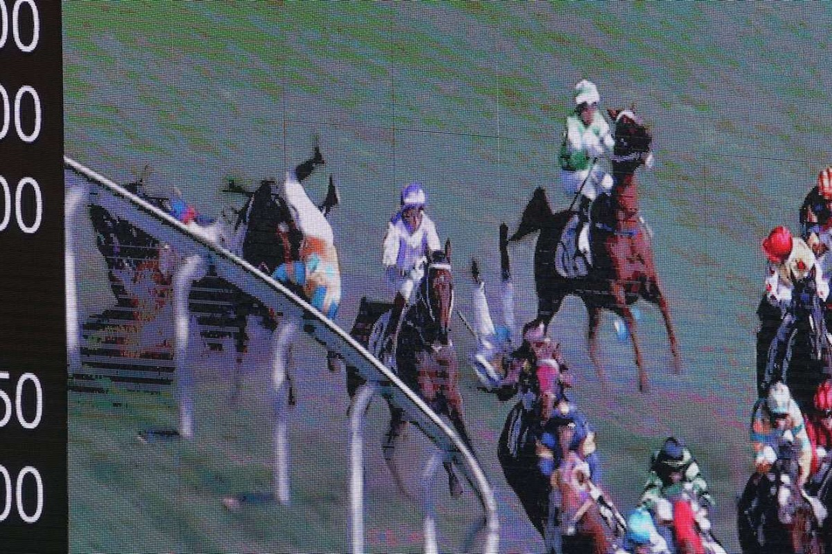 Umberto Rispoli (Mr Pele) and Jack Wong (Dashing King) tangle in a nasty tumble at Happy Valley.