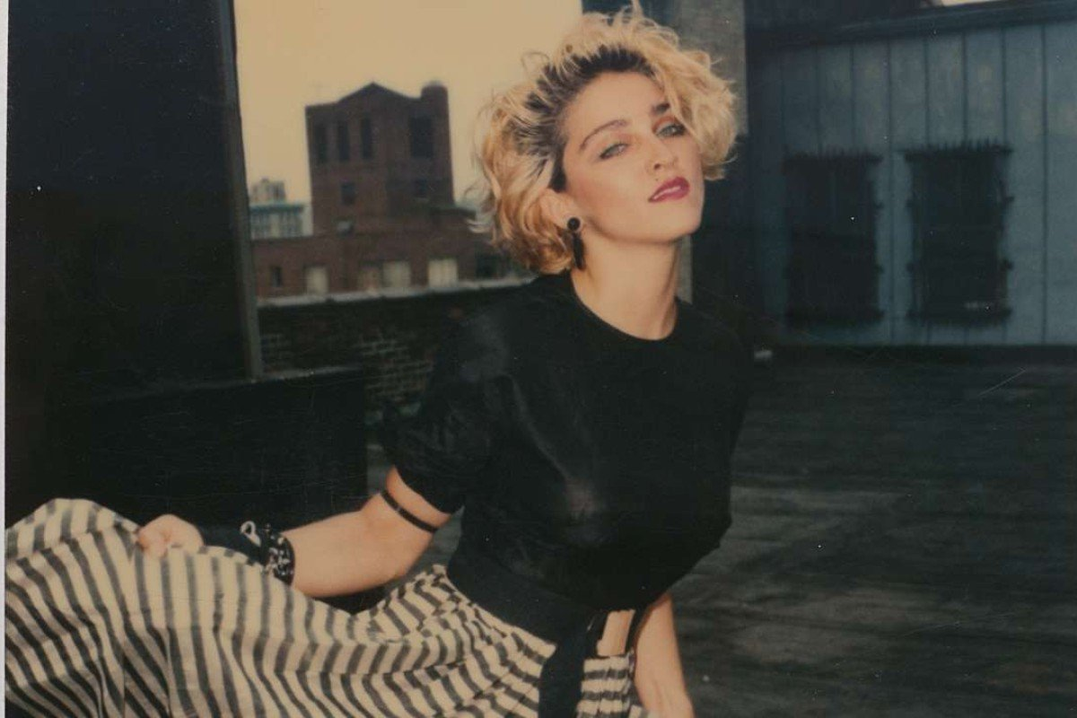 Madonna on the roof of her brother's flat in this Polaroid image, one of 66 shot by photographer Richard Corman on June 17, 1983, and published in a new book, Madonna 66.