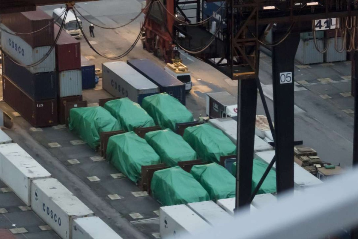 Nine Singapore-made Terrex infantry carrier vehicles seized in Hong Kong lie under tarpaulin. Photo: AFP