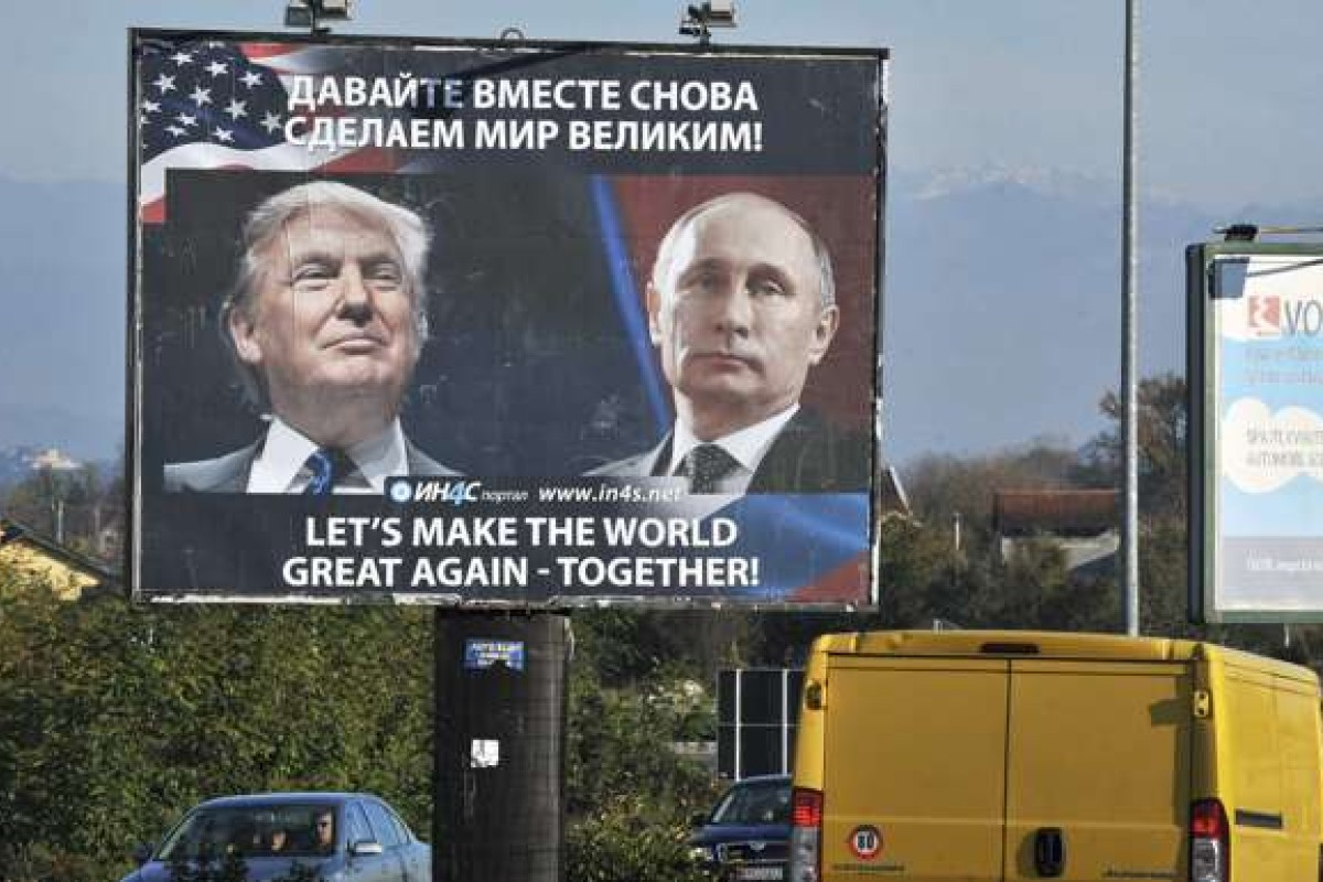 Cars pass by a billboard showing US President-elect Donald Trump and Russian President Vladimir Putin in the town of Danilovgrad. Photo: AFP