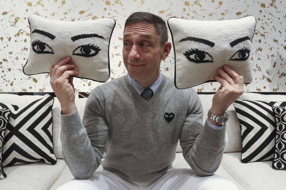 Jonathan Adler with Eye throw pillows. Picture: Jonathan Wong