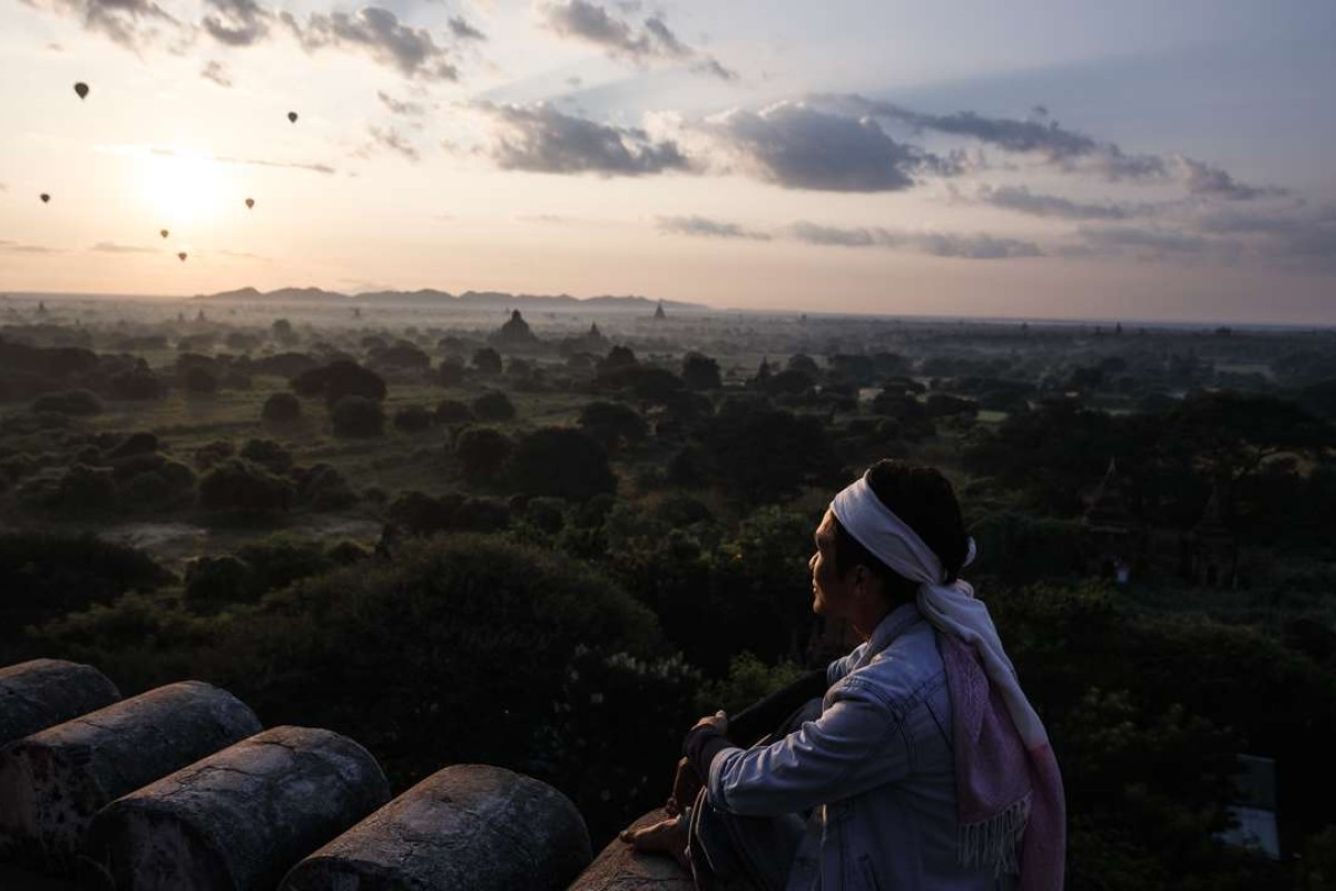 Hot air balloons take tourists on a sunrise tour over Bagan's ancient temples. Pictures: AFP; Jamie Carter