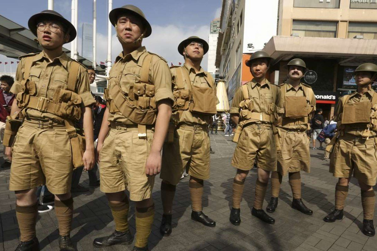 Watershed Hong Kong members in the uniforms of the Hong Kong Volunteer Defence Corps, in Tsim Sha Tsui, in December. Picture: Jonathan Wong