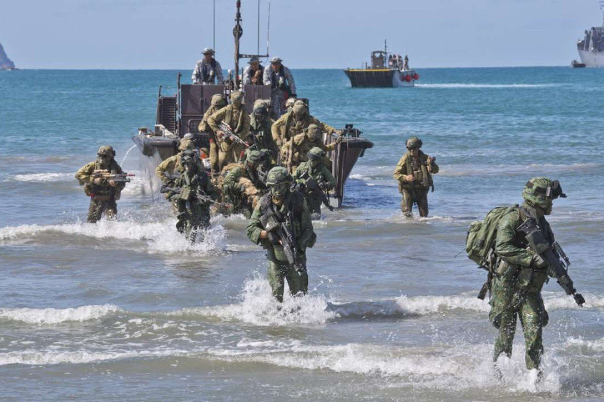 Australian Army soldiers from 7th Battalion, Royal Australian Regiment, and Singapore Army soldiers disembark a Fast Craft Utility landing vessel at Shoalwater Bay training area, Queensland. Photo: Handout