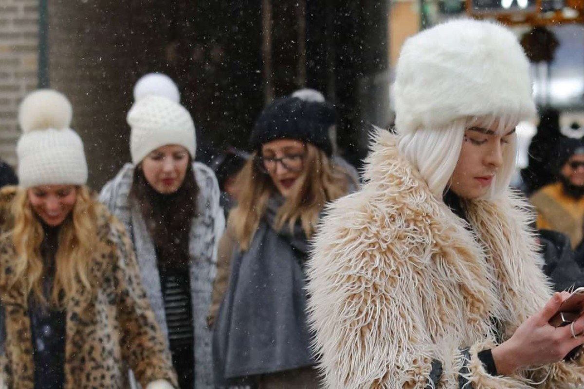 Guests brave a snow storm to view the Tadashi Shoji fashion show at New York Fashion Week. Photo: AP