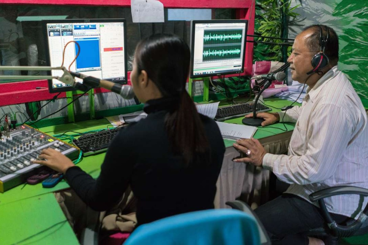 Kong Duong (right), Pol Pot's former chief propagandist, hosts his Christian radio show. Pictures: Thomas Cristofoletti