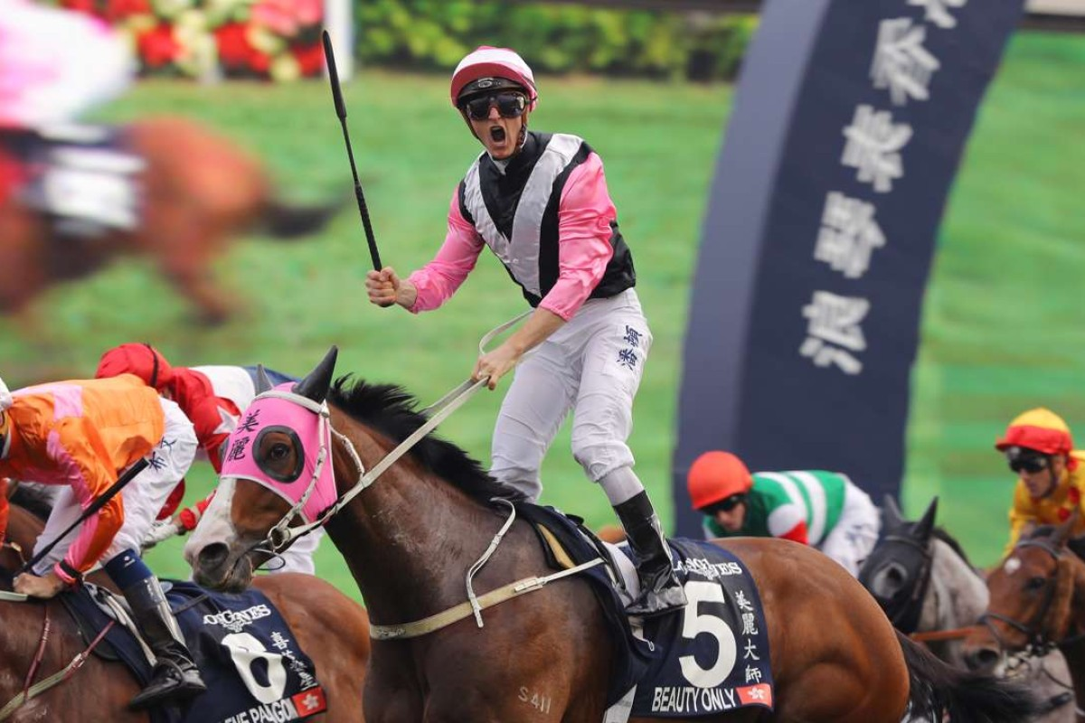 Zac Purton celebrates after winning the Group One Hong Kong Mile with Beauty Only. Photos: Kenneth Chan