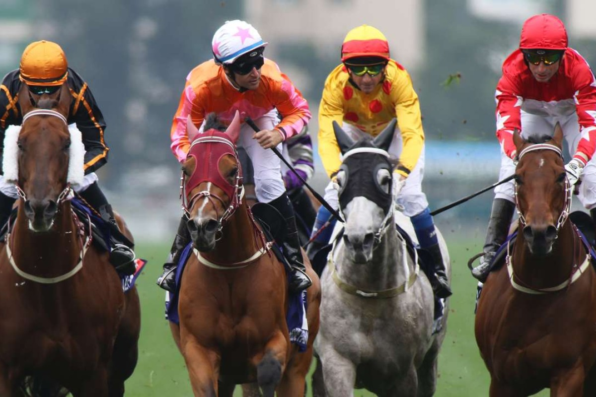 Tommy Berry (second from left) looks to connections after winning the Group One Queen's Silver Jubilee Cup on Helene Paragon. Photos: Kenneth Chan