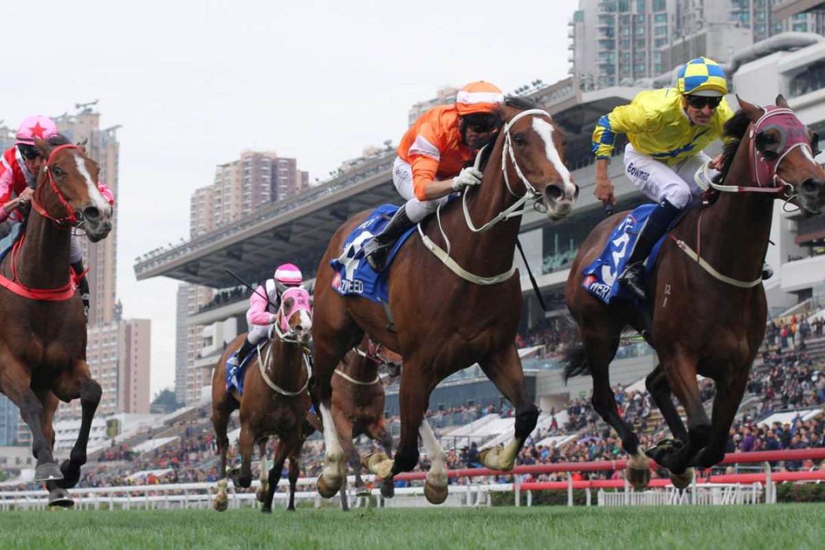Hugh Bowman (right) lifts Werther to victory in the Group One Citi Hong Kong Gold Cup. Photos: Kenneth Chan