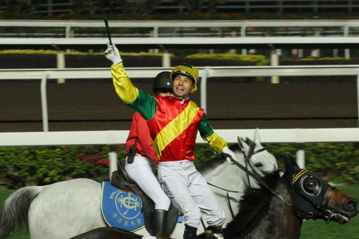 Joao Moreira throws his whip in delight after winning on Grand Harbour. Photos: Kenneth Chan