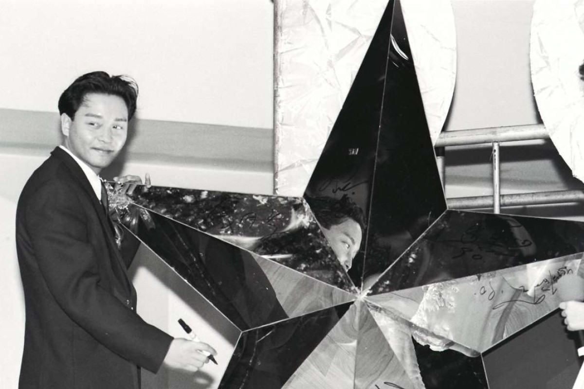 Singer-actor Leslie Cheung Kwok-wing signing his name on the star as one of the Ten Most Famous Personalities.