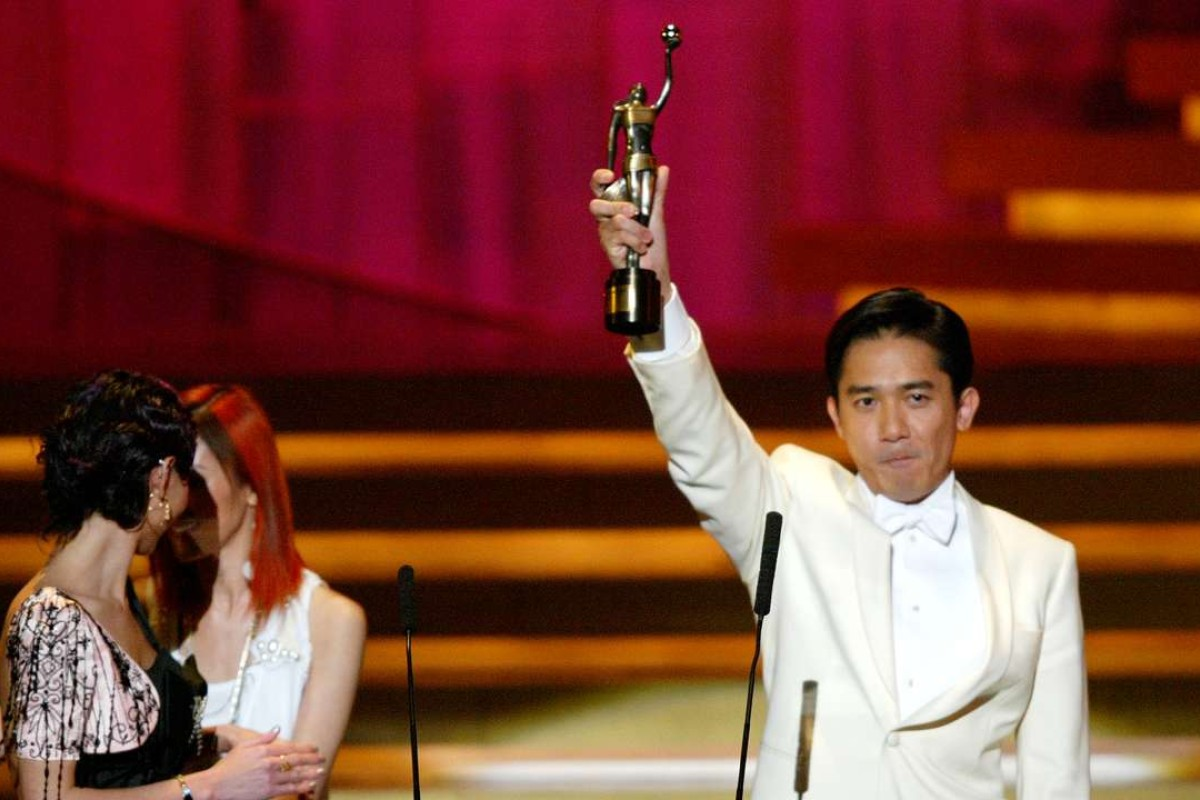THE 24TH Hong Kong Film Awards presentation ceremony at the Hong Kong Coliseum. Tong Leung Chiu-wai holding up his Best Aactor Award to celebrate at the ceremony.