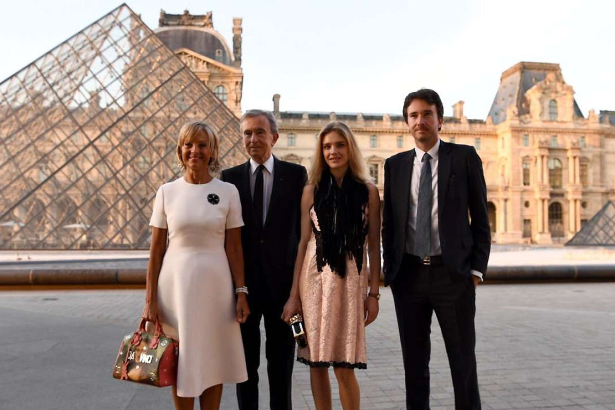 CEO of LVMH Bernard Arnault (second from left), his wife French pianist Helene Mercier-Arnault, their son French businessman Antoine Arnault and his wife Russian model Natalia Vodianova at the launch of Louis Vuitton x Jeff Koons at the Louvre. Photo: AFP