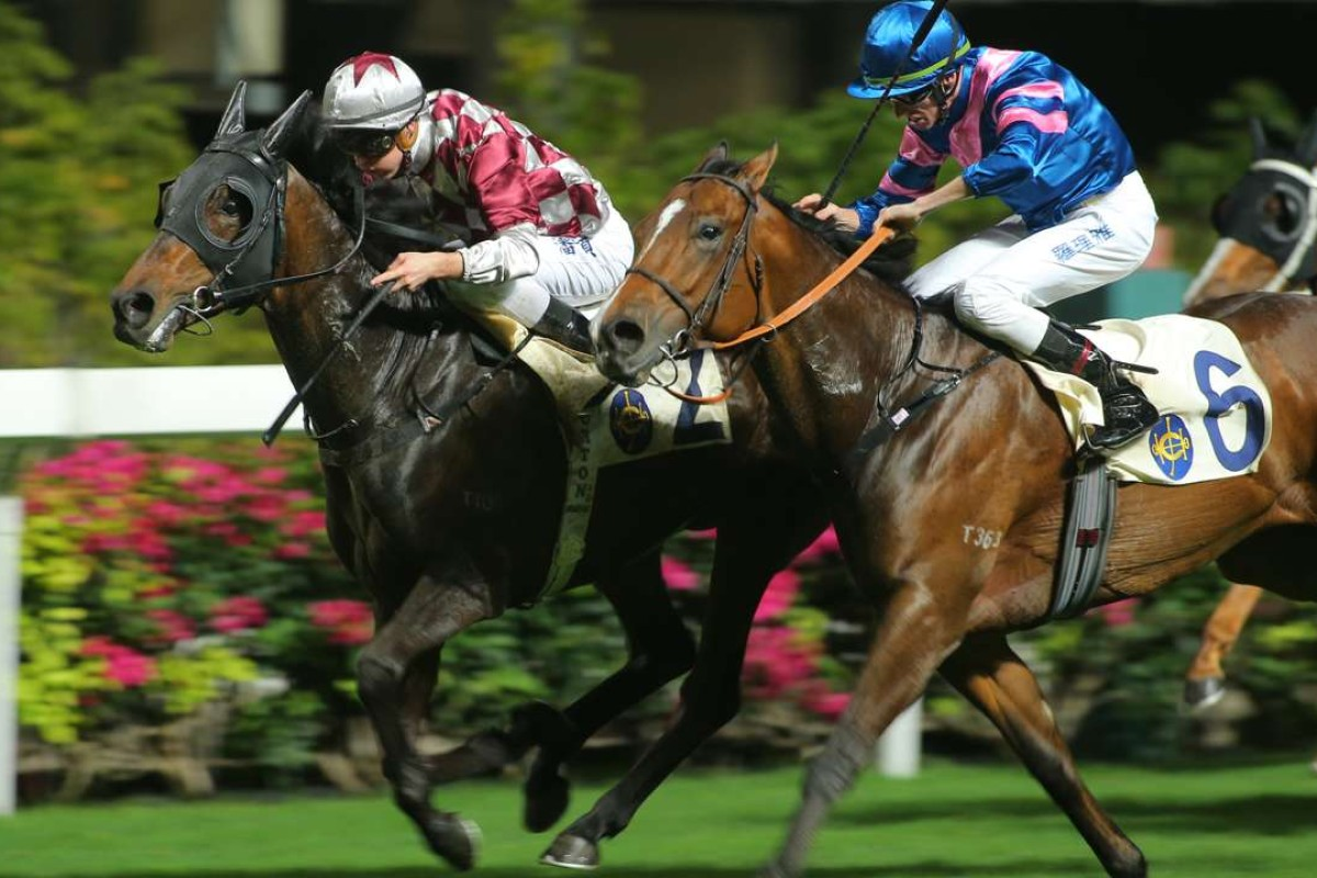 Zac Purton and Andoyas (left) hold off Nash Rawiller and Happy Contender at Happy Valley on Wednesday night. Photos: Kenneth Chan