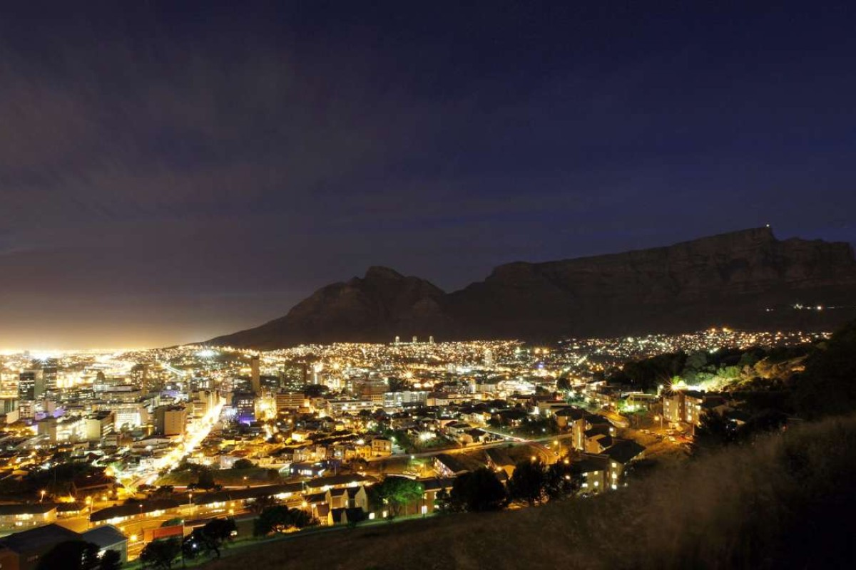 Cape Town lights up at dusk. Picture: Reuters